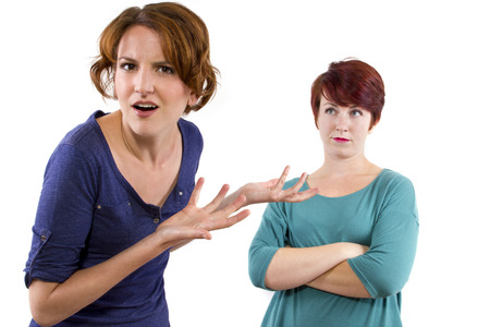 two Caucasian women arguing and distrusting each other Stock Photo