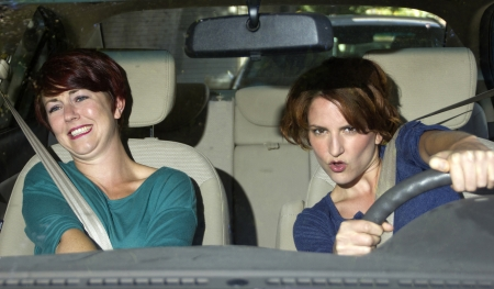 reckless: reckless driver and scared female passenger inside a car