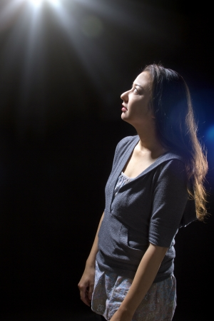 young woman seeing bright glowing orbs from above photo