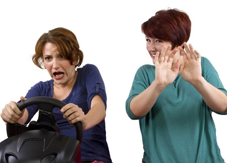 reckless driver and scared female passenger on white background  photo