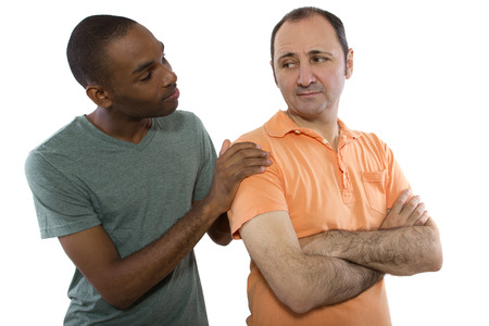 Interracial gay couple going through relationship problems photo