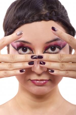 nailart: trendy cosmetic designs of make up and nail polish Stock Photo