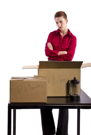 stuff: woman stressed out and packing stuff