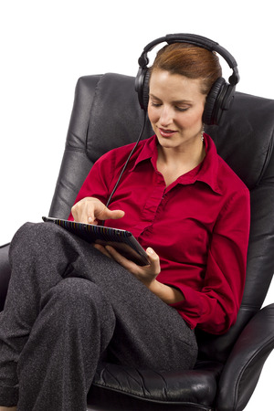 woman watching streaming programing on tablet photo