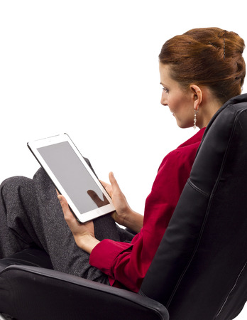 woman looking at tablet computer  blank screen for composites  photo