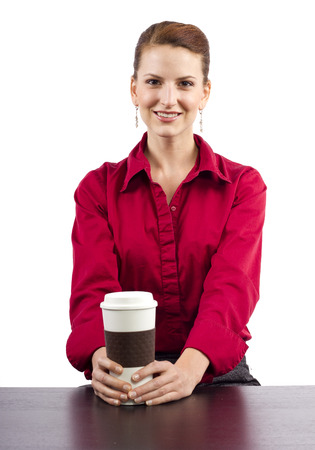woman serving coffee behind the counter Foto de archivo