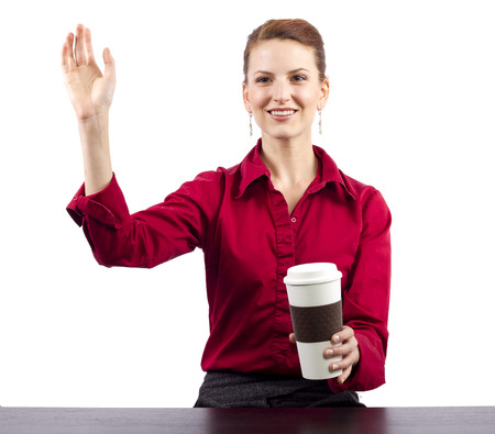 woman serving coffee behind the counter photo