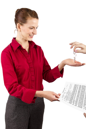 seller: Woman holding keys and a deed of sale contract