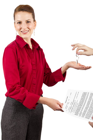 Woman holding keys and a deed of sale contract photo