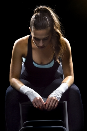 mixed martial arts: female MMA fighter in a black background