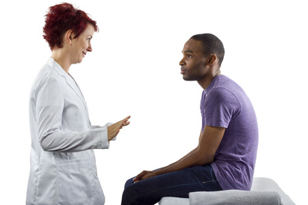 young female therapist consulting male client about posture Stock Photo