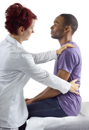 therapist: young female therapist consulting male client about posture Stock Photo
