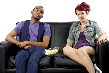 roommates: multi-racial male and female roommates sharing a couch