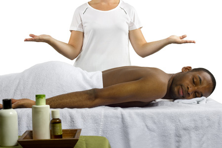 masseuse showing off spa products for men photo