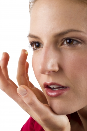 aging: woman applying anti aging cream ointments Stock Photo
