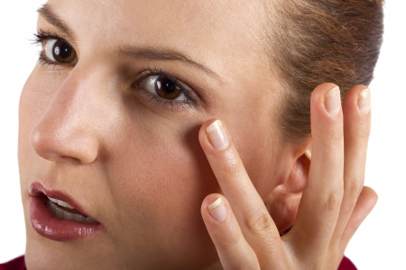 woman applying anti aging cream ointments Stock Photo