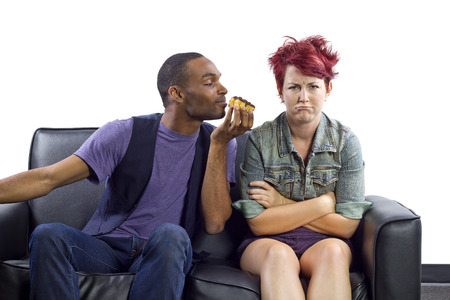male refusing to share food with female roomate photo