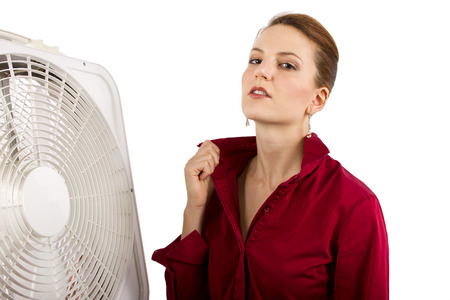 Businesswoman cooling off with a fan  photo