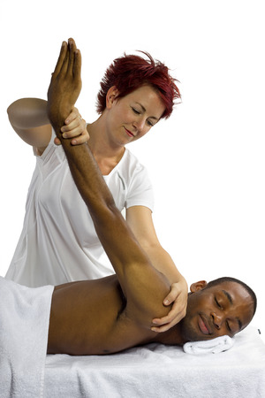 african american spa: young female therapist helping young male patient
