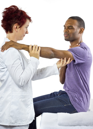 muscle retraining: young female therapist helping young male patient