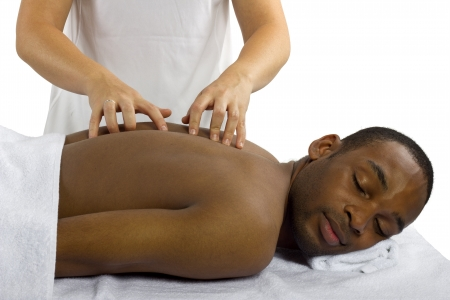 female therapist: young female therapist examining male patients spinal column Stock Photo