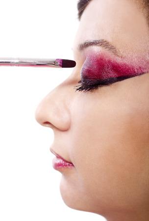make up artist: make up artist applying make up on model