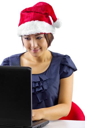 Asian woman wearing a santa hat on webcam photo