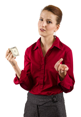 underpaid: Young woman holding a dollar bill Stock Photo