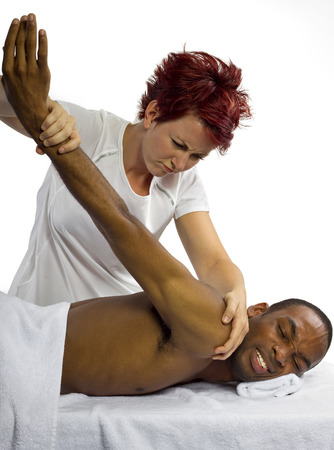 inexperienced: young inexperienced female masseuse hurting her male patient