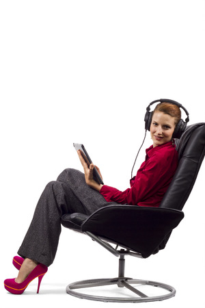 earphone: Woman listening to audio books on a tablet