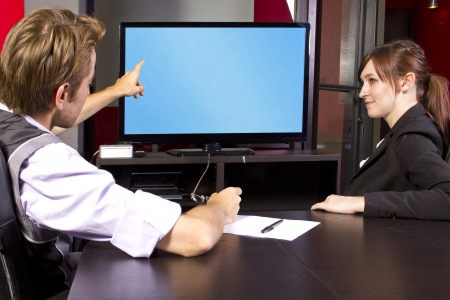 Business team watching a blank tv screen Stock Photo