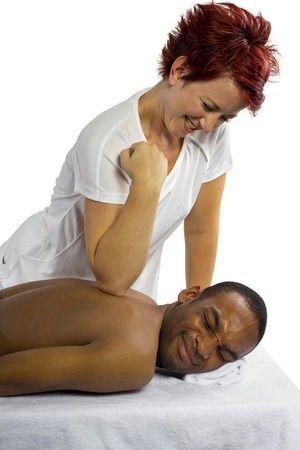 young inexperienced female masseuse hurting her male patient photo