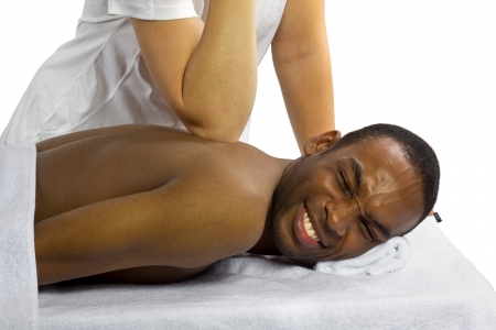 young inexperienced female masseuse hurting her male patient