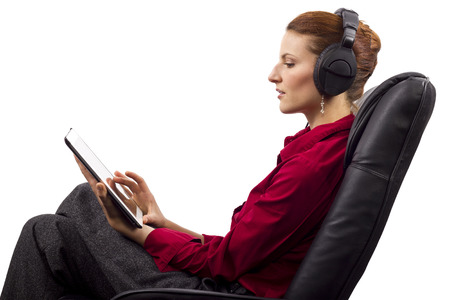 Woman listening to audio books on a tablet photo