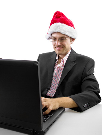 businessman celebrating Christmas by web chat on a computer photo