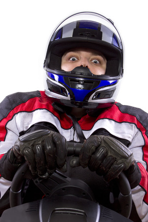 young female race car driver in a racing suit and helmet Stock Photo