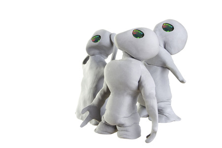 gray alien made of clay on a white background photo