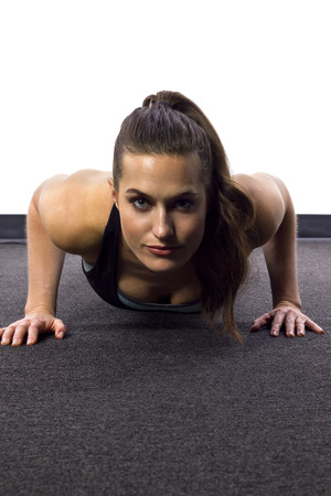push up: young Caucasian woman doing push ups