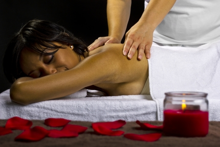 young female getting a massage in a dark intimate room Stock Photo - 23840018