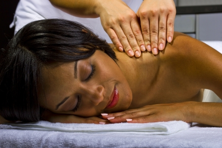 young African American female getting a massage in a spa Stock Photo - 23840022