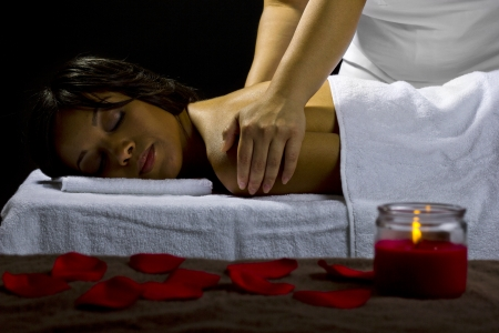 young female getting a massage in a dark intimate room Stock Photo - 23840024