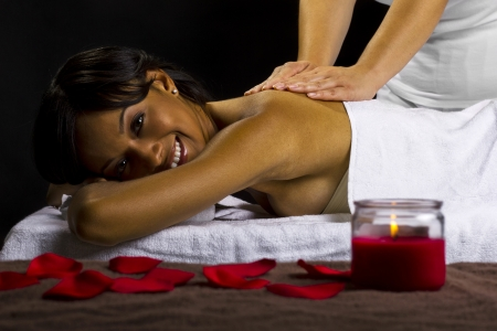 young female getting a massage in a dark intimate room Stock Photo - 23840026