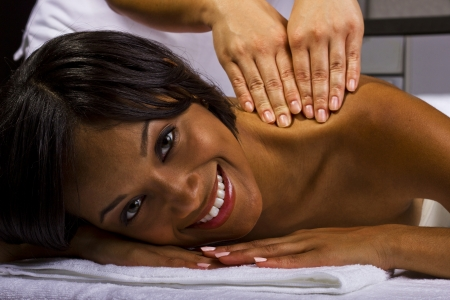 young African American female getting a massage in a spa Stock Photo - 23840029