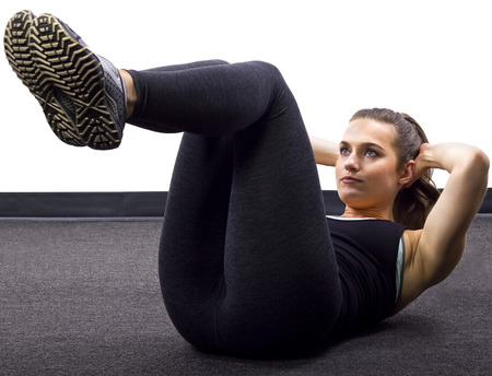 young Caucasian woman doing situps crunches photo