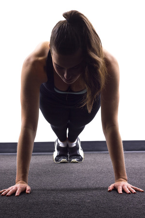 woman working out: young Caucasian woman doing push ups