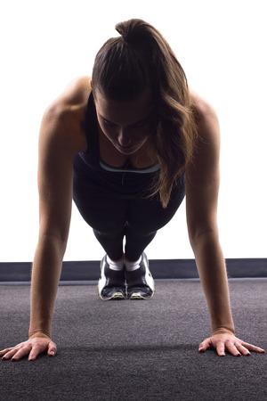 push ups: young Caucasian woman doing push ups