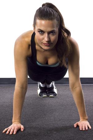 push: young Caucasian woman doing push ups