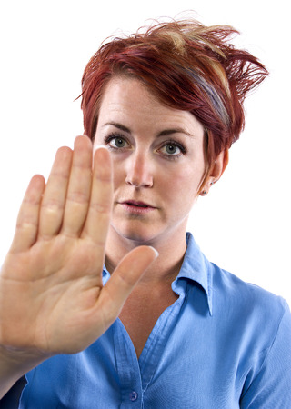 young redhead woman holding out her palm Stock Photo