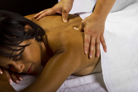 young African American female getting a massage in a spa Stock Photo - 23840282