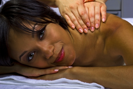 young African American female getting a massage in a spa Stock Photo - 23840284